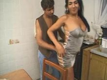 Horny tranny sucks on kitchen table