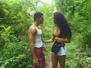 Two guys fuck brunette shemale and jizz in forest