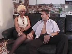 Guy and blond shemale in stockings suck each other